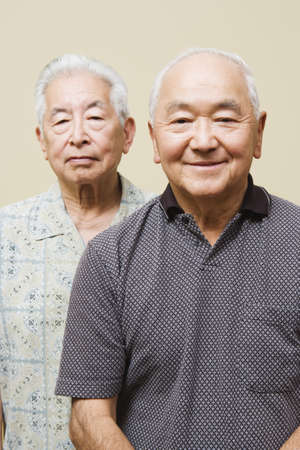above 30: Portrait of two elderly men wearing glasses