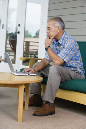 above 30: Elderly man working on laptop