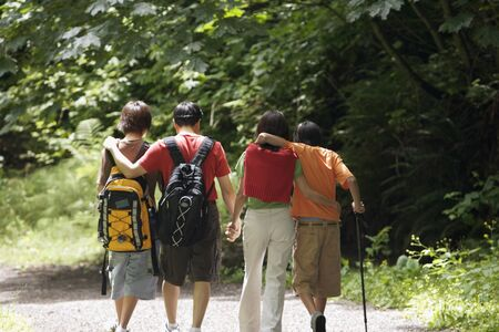 some under 18: Rear view of family hiking
