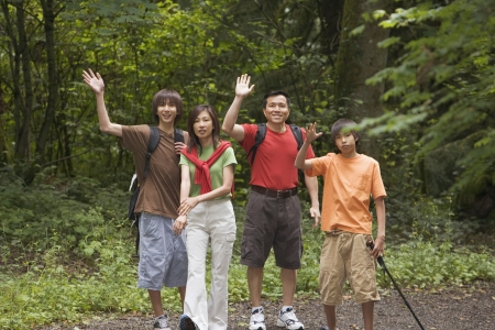 Portrait of family waving