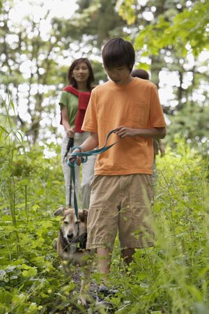 some under 18: Family hiking with dog LANG_EVOIMAGES