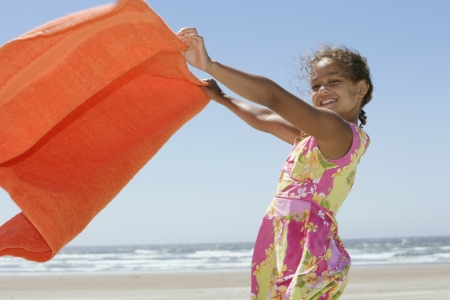 all under 18: Portrait of girl holding towel at beach