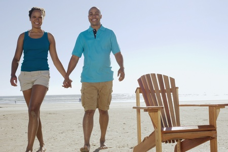 adirondack: Portrait of couple holding hands and walking on beach