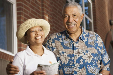 aging american: Portrait of elderly couple smiling LANG_EVOIMAGES