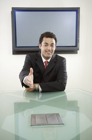 Businessman extending his hand in welcome Stock Photo - 16072064