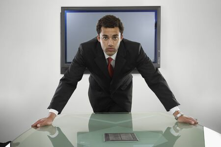 irish ethnicity: Young businessman leaning toward camera
