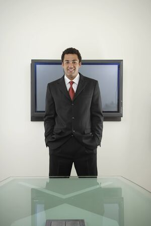 Businessman standing with hands in pockets Stock Photo - 16072069