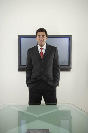 irish ethnicity: Businessman standing with hands in pockets