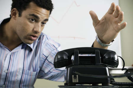 irish ethnicity: Man reaching for old fashioned telephone