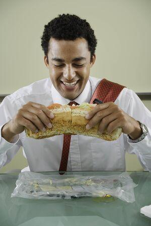 irish ethnicity: Businessman eating big sandwich
