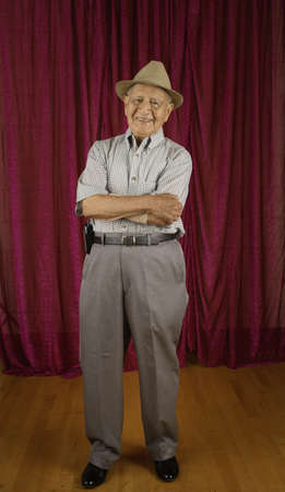 above 30: Elderly man standing with arms crossed