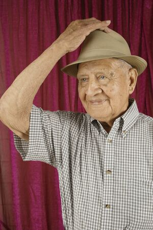 tipping: Elderly man tipping his hat