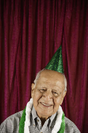 silliness: Smiling man in party hat