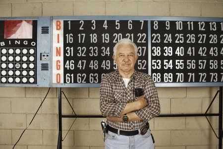 Man standing in front of bingo board Stock Photo - 16072087