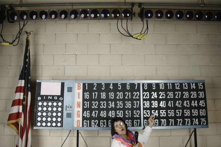announcing: Woman announcing bingo number