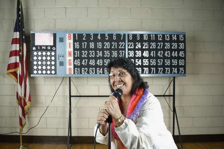 Woman with microphone in front of bingo board Stock Photo - 16072092