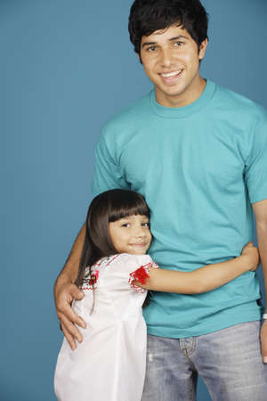 Young girl and young man smiling at camera Stock Photo - 16072104