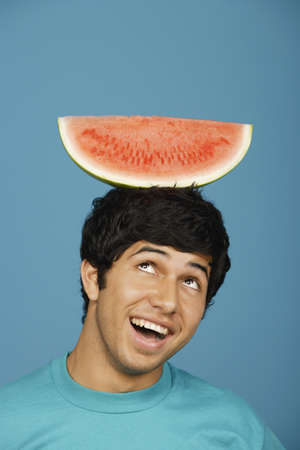silliness: Man balancing watermelon slice on head