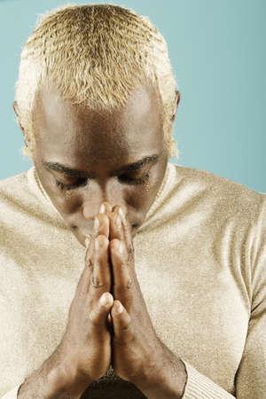 Young man in prayerful attitude Stock Photo - 16072115