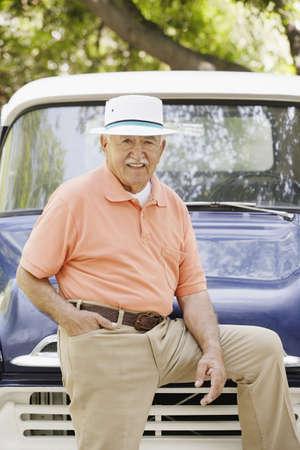 30 s: Portrait of elderly man leaning on old pickup truck