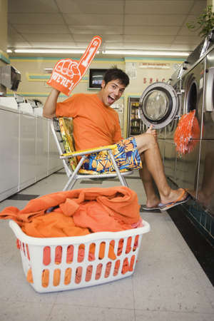 Portrait of man with team spirit at laundromat Stock Photo - 16072154
