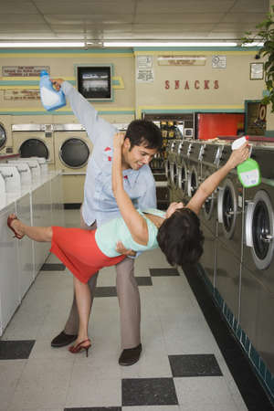 Couple dancing with soap in laundromat Stock Photo - 16072160