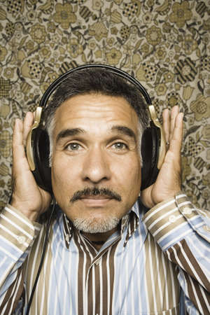 Close up portrait of man with headset listening to music Stock Photo - 16072165