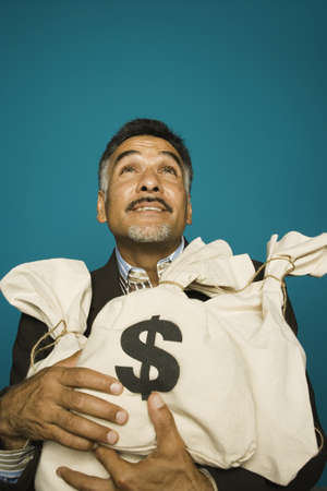 Man holding bags of money Stock Photo - 16072166