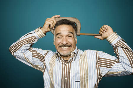 Portrait of man with clamp tightened on head Stock Photo - 16072169