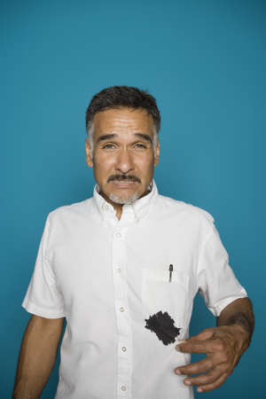 Portrait of man with ink spilled on shirt Stock Photo - 16072171