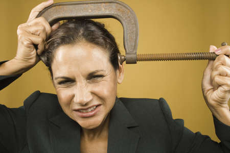 Portrait of businesswoman with clamp on head Stock Photo - 16072177
