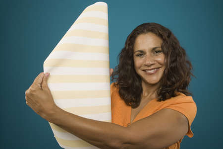Portrait of woman with roll of wallpaper Stock Photo - 16072183