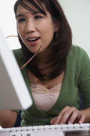 Close-up of young woman at computer Stock Photo - 16043280
