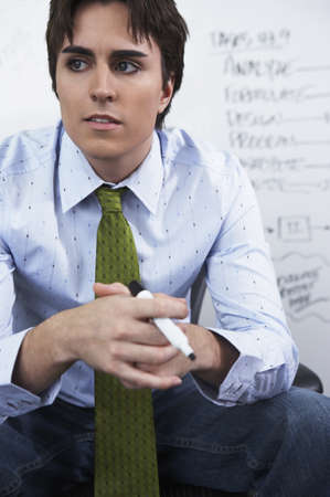 Young businessman looking pensive Stock Photo - 16072187
