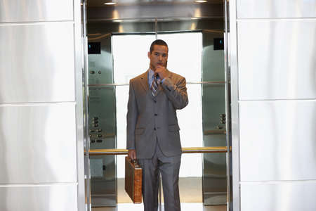 Young businessman inside elevator Stock Photo - 16072194