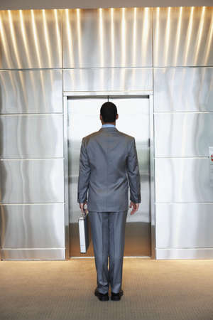 Businessman waiting for elevator Stock Photo - 16072196