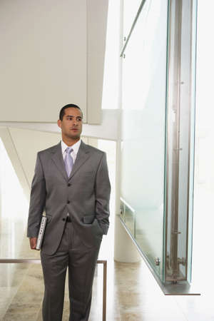 Businessman carrying laptop computer Stock Photo - 16072198