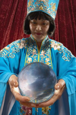 Portrait of magician holding crystal ball Stock Photo - 16072241