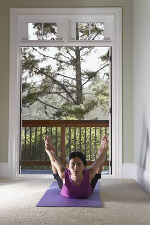 mill valley: Woman laying on mat stretching
