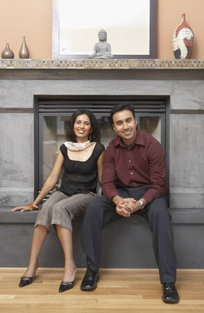 mill valley: Portrait of couple sitting in front of fireplace LANG_EVOIMAGES