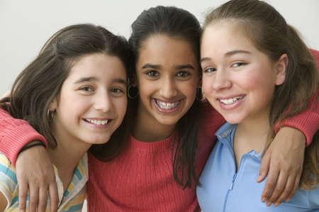 all under 18: Portrait of three girls smiling