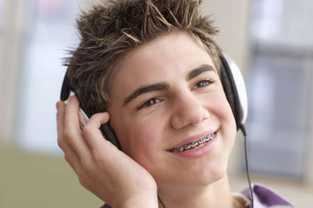 Close up of teenage boy with headset smiling Stock Photo - 16072325