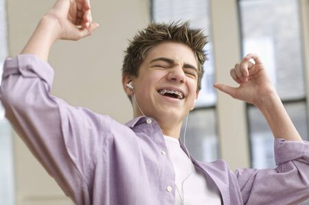 Teenage boy excited listening to music Stock Photo - 16072326