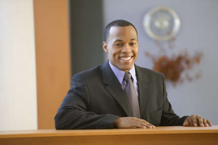 above 25: Portrait of African American businessman smiling