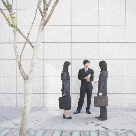 sidewalk talk: Businessman and businesswomen talking