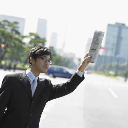 hailing: Businessman hailing cab