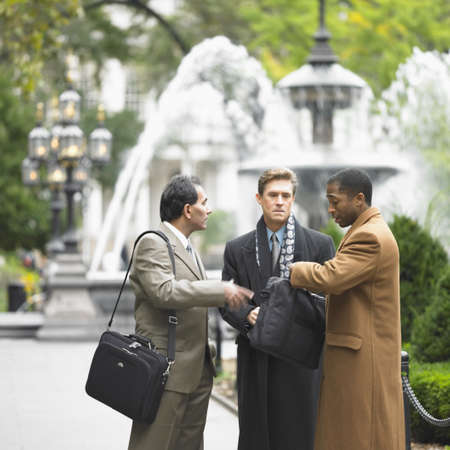 Businessmen talking Stock Photo - 16072497