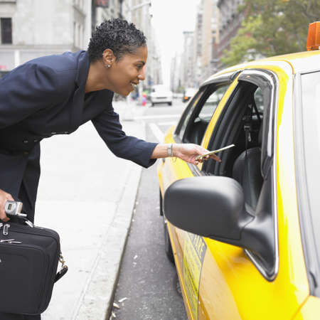 paying: Businesswoman paying cab fare