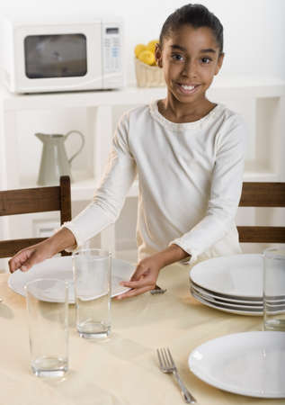 table: Girl setting kitchen table