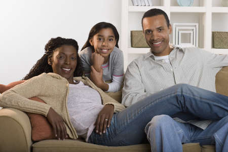 some under 18: Portrait of family sitting on couch
